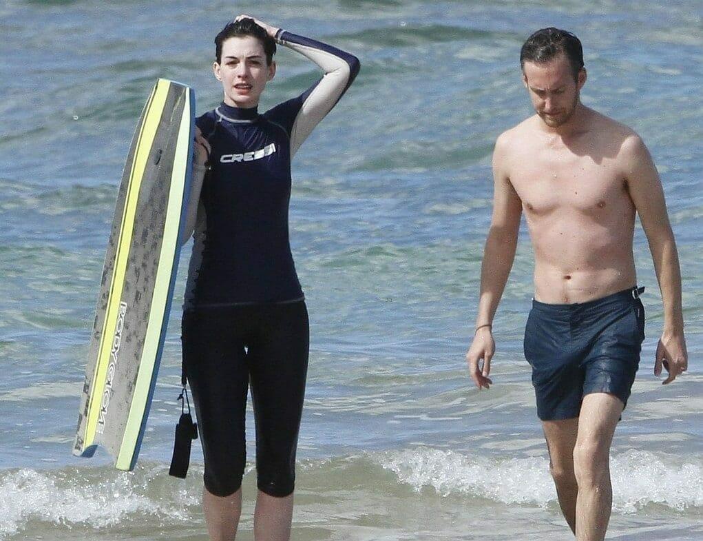 Adam Shulman with Anne Hathaway at the beach