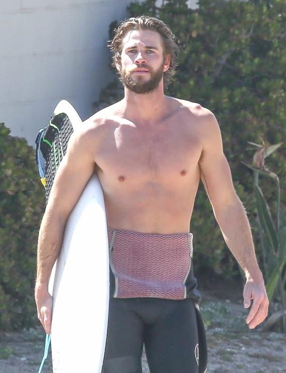 Liam Hemsworth surfing shirtless