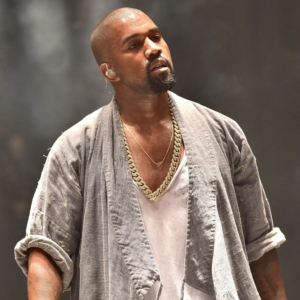 Kanye West showing muscles