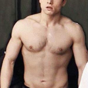Taron Egerton chest